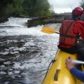 Water Rafting into rapids at AWOL